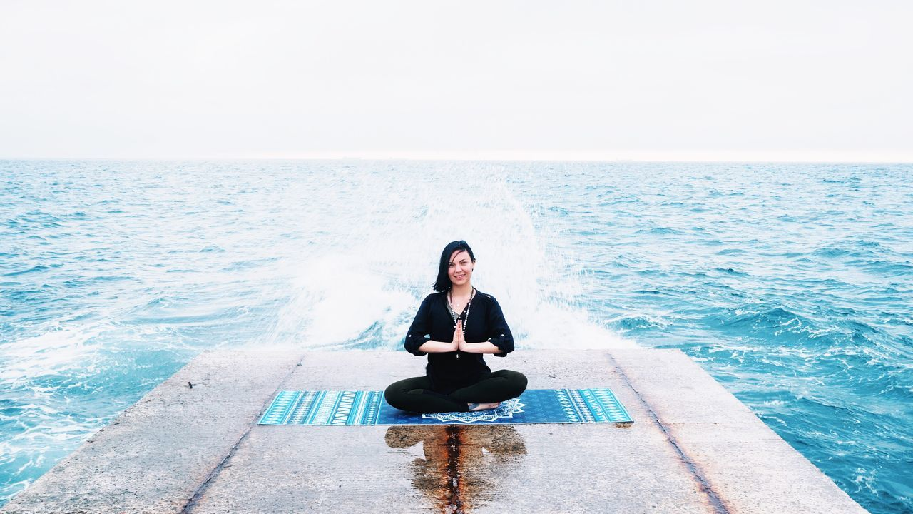 Sea Yoga Meditating Tranquil Scene Beauty In Nature Sitting Zen-like One Person Horizon Over Water Women Water Scenics Copy Space Adult Cross-legged One Woman Only Relaxation Full Length Nature Sky Lotus Namaste ❤ Praying Mandala Odessa