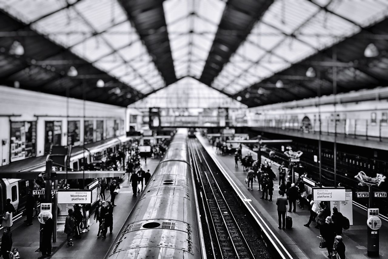 People And Places Transportation Large Group Of People Public Transportation Railroad Station Peoplephotography EyeEm Light And Shadow EyeEm Best Shots - Black + White EyeEm London EyeEm Best Shots From My Point Of View IPhoneography Urban Exploration Urban Lifestyle Iphoneonly EyeEmBestPics Notes From The Underground LONDON❤ London City Life Train Train Station Transportation Lines