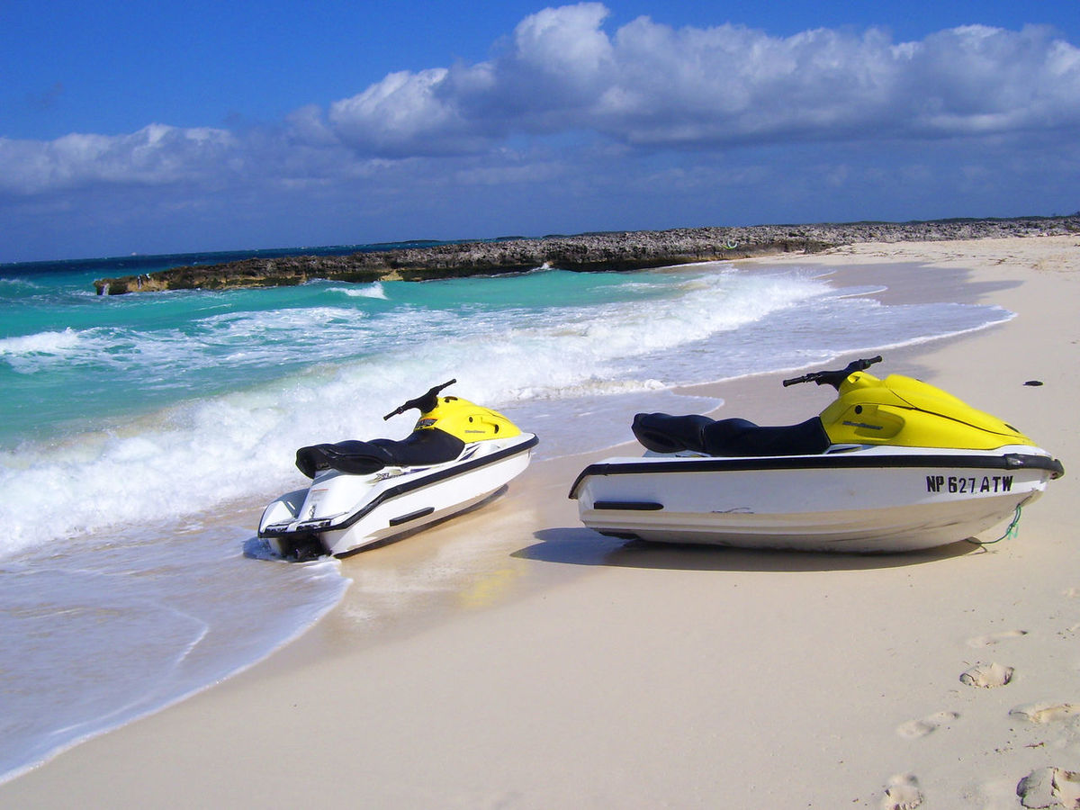 Beach Beauty In Nature Cloud - Sky Day Horizon Over Water Jet Boat Jetskis Leisure Activity Mode Of Transport Moored Nature Nautical Vessel No People Outdoors Outrigger Recreational Pursuit Scenics Sea Sky Sunlight Transportation Vacation Water Water Craft