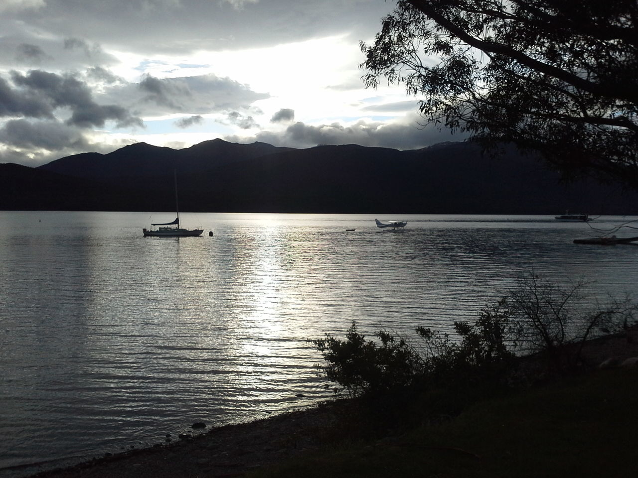 Dusk in Te Anau Relaxing Travel Destinations Travel Photography Beautiful Nature Refelections Tranquility Yacht Seaplane Dusk Sky Dusk EyeEm Nature Lover South Island New Zealand TeAnau Silhouettes