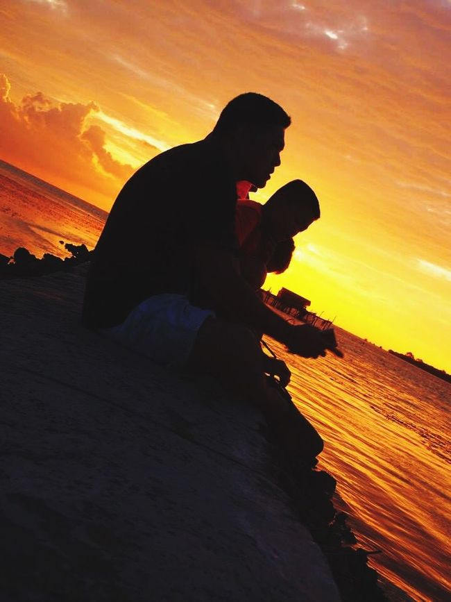 Learn & Shoot: Single Light Source Father and son enjoying sunset Sunset_collection Sillhouette Sunsetphotographs Eyeemindonesia EyeEm Sunset