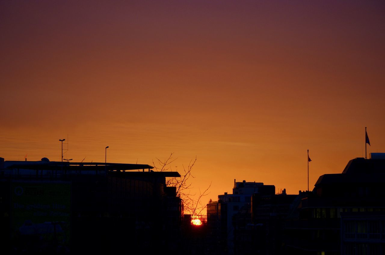 From Dusk till Dawn. Architecture Building Exterior Built Structure City City Scape Cityscape Cloudless Sky Day Evening Evening Light Evening Sky High Contrast Last Sunbeam No People Orange Color Orange Sky Sunset Outdoors Over The Roofs Roofs Shadow Silhouette Skyline Sun At Horizon Sun At The Horizon Sunset