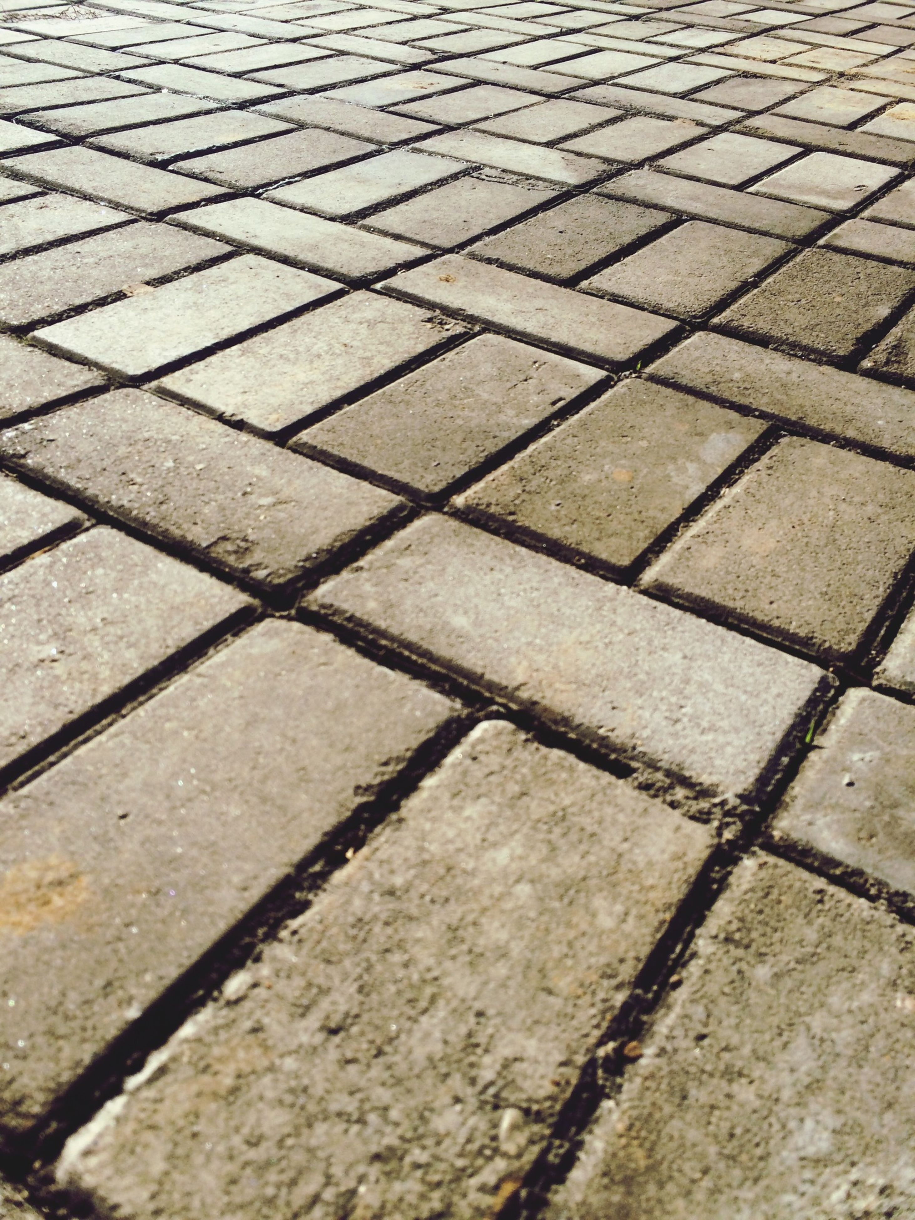 high angle view, full frame, street, pattern, backgrounds, paving stone, cobblestone, textured, footpath, sunlight, shadow, sidewalk, asphalt, day, outdoors, no people, road, road marking, pavement, close-up