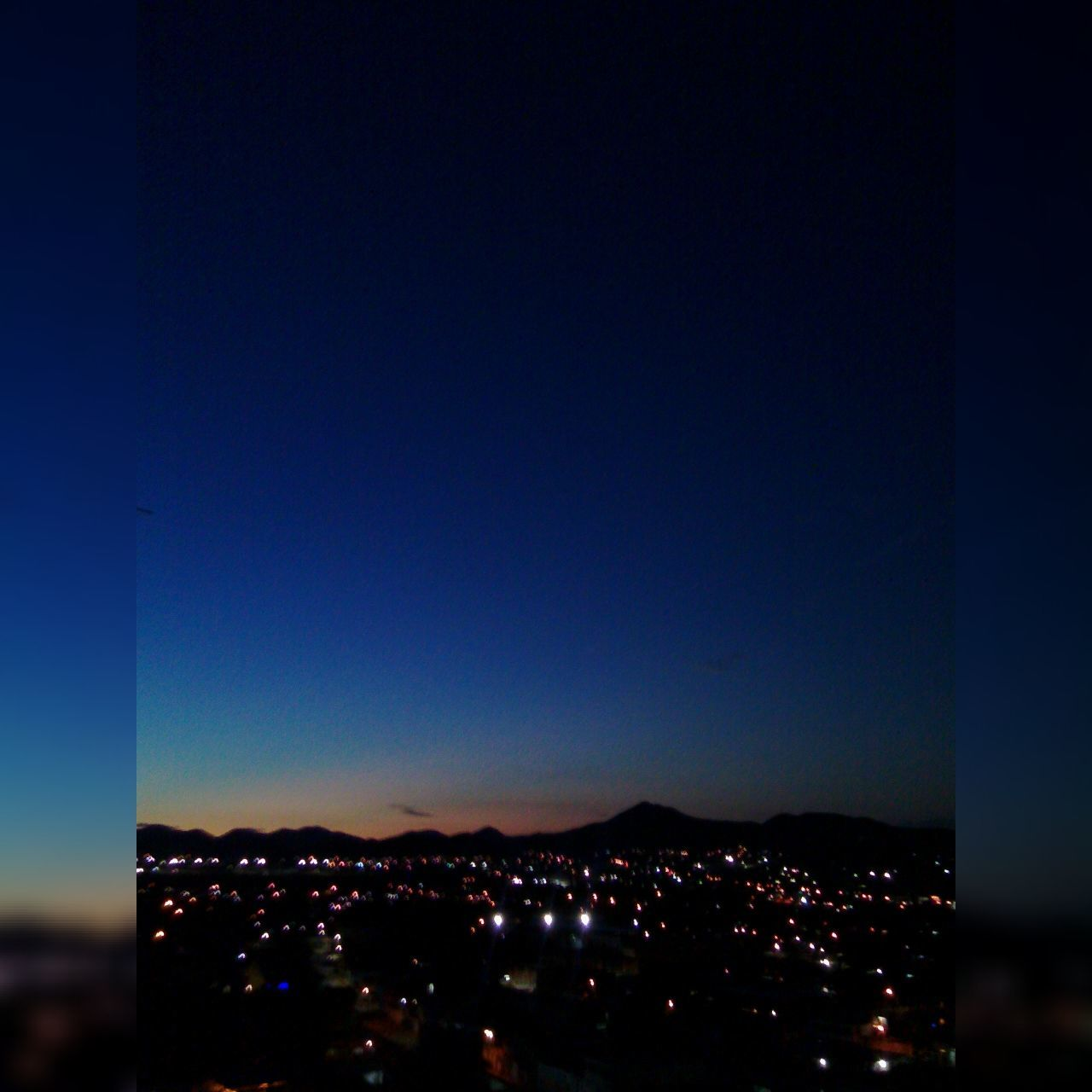 B A R Q U I S I M E TO O R N I G H T. Blue City City Life Cityscape Clear Sky Dark Illuminated Modern Mountain Range Night Sky