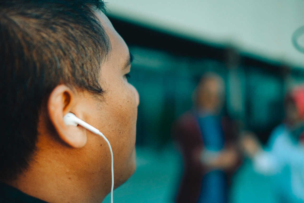 A man with earphone Adult Close-up Day Earphone EarPhonePlug Earphones Focus On Foreground Headshot Indoors  Leisure Activity Men One Person People Real People Young Adult