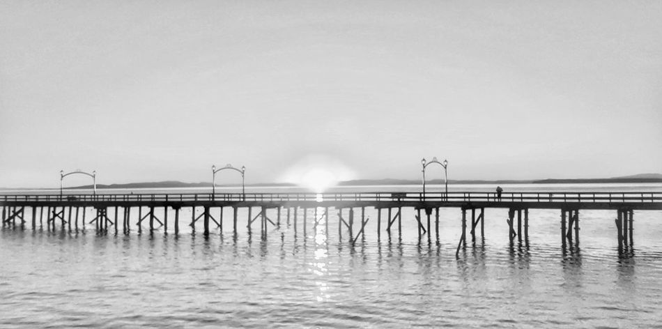 Sea Water Outdoors Beach Nature Wave Fog Day Sand Sky No People Horizon Over Water Bridge - Man Made Structure Backgrounds Travel Destinations Tranquility Tranquil Scene Togetherness Vacations Idyllic Reflection Sunset Dusk Sunlight Digital Camera