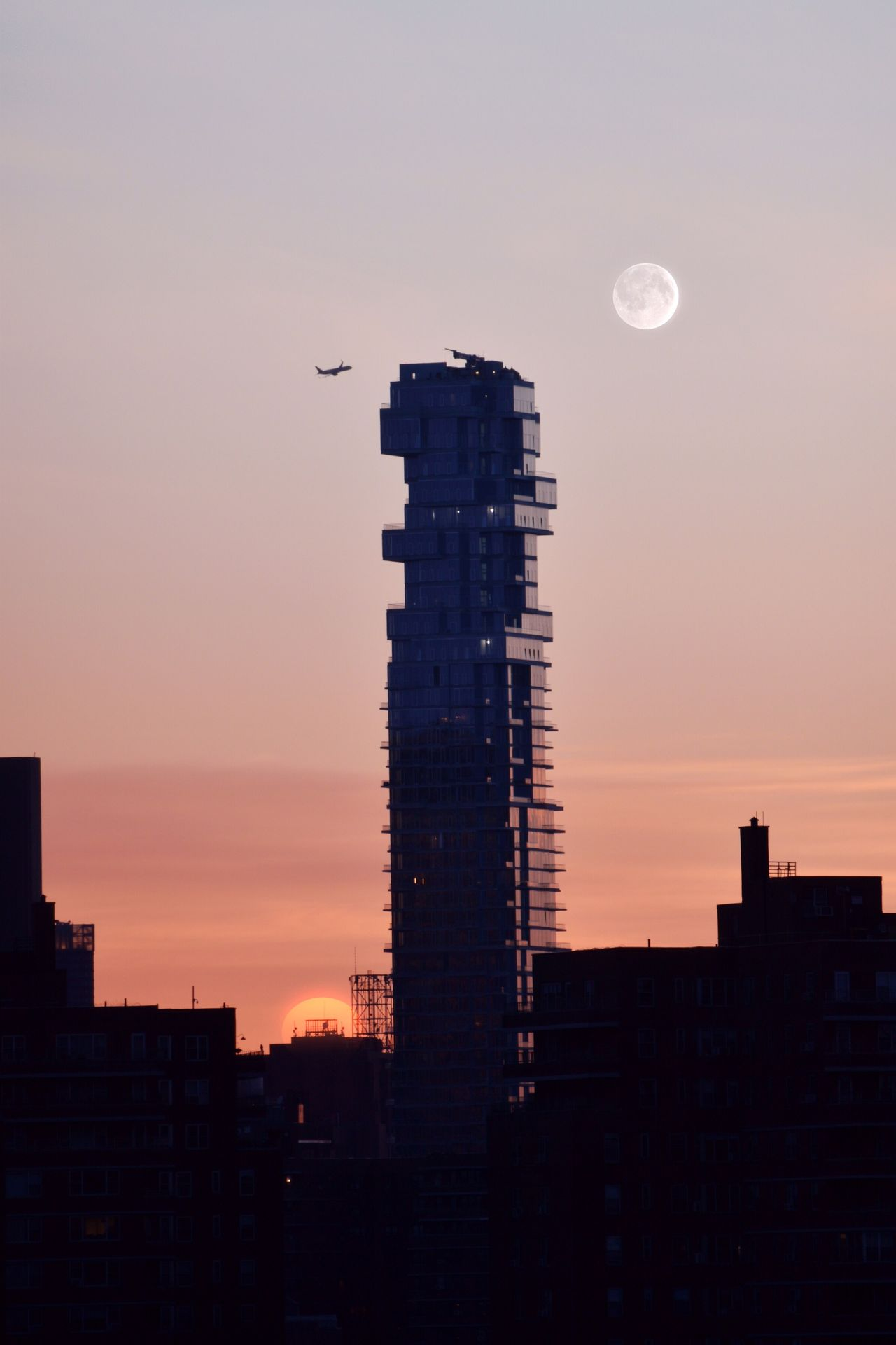Moon Plane Plane And Moon Sunset Sunset Silhouettes Sunset_collection Jengatower 59leonard Moon Architecture Built Structure Building Exterior Skyscraper Dusk Sky Silhouette City Nature No People Beauty In Nature Outdoors Travel Destinations Scenics Crescent Low Angle View Modern Clear Sky