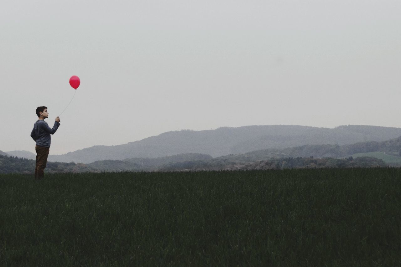 Hope in a grey world... Autumn Ballon Capture The Moment Child Landscape Mountains People Red Simplicity One Wild Night Landscapes With WhiteWall Telling Stories Differently TakeoverContrast
