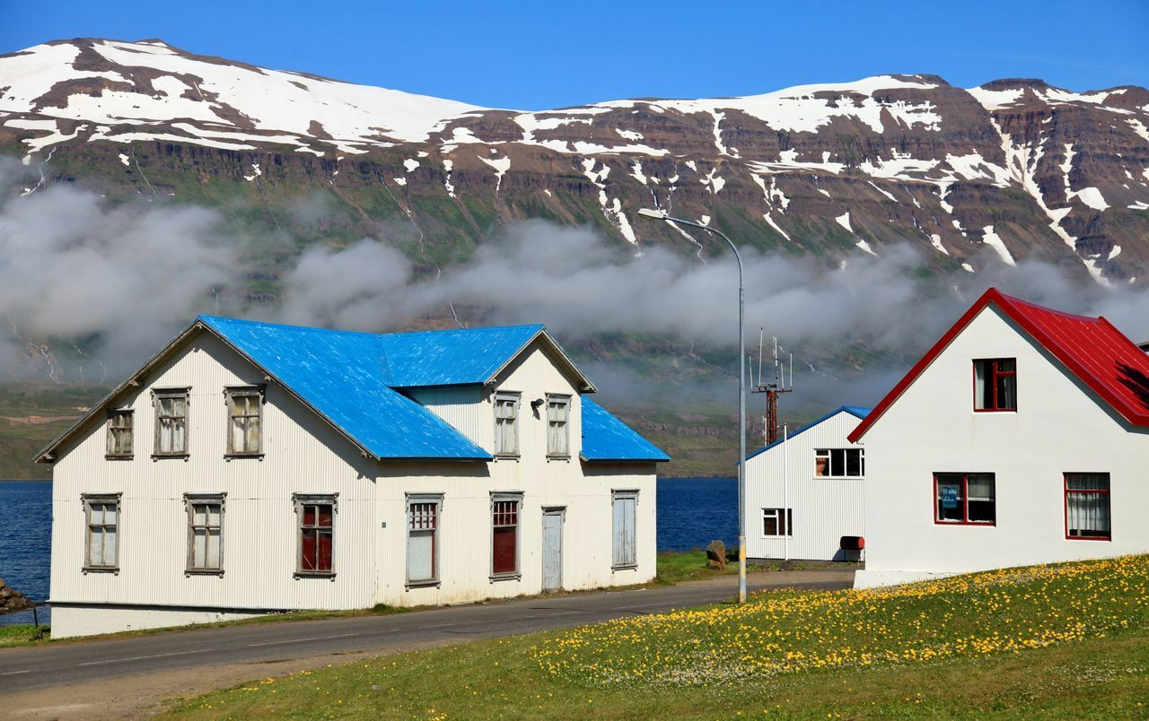 Houses in Seydisfjordur, Iceland Blue Color Clouds Houses Iceland Mountain Range Multi Colored No People Red Color Scenics Seyðisfjörður Tranquil Scene Voyage Of The Vikings