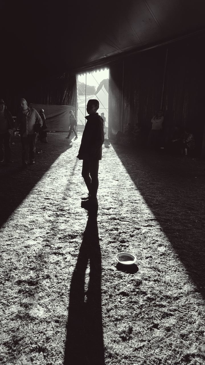 sunlight, shadow, full length, real people, one person, silhouette, walking, day, lifestyles, the way forward, men, outdoors, one man only, adult, people