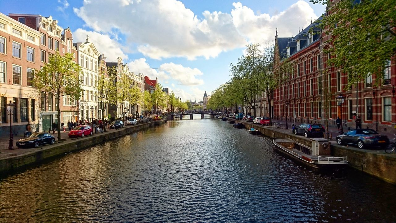 Amsterdam Spring Springtime Cloud - Sky cloud - sky Water Sky Reflection Wet Architecture Building Exterior Day Built Structure Outdoors Travel Destinations Flood Multi Colored No People Channels First Eyeem Photo Holland Dutch EyeEmNewHere