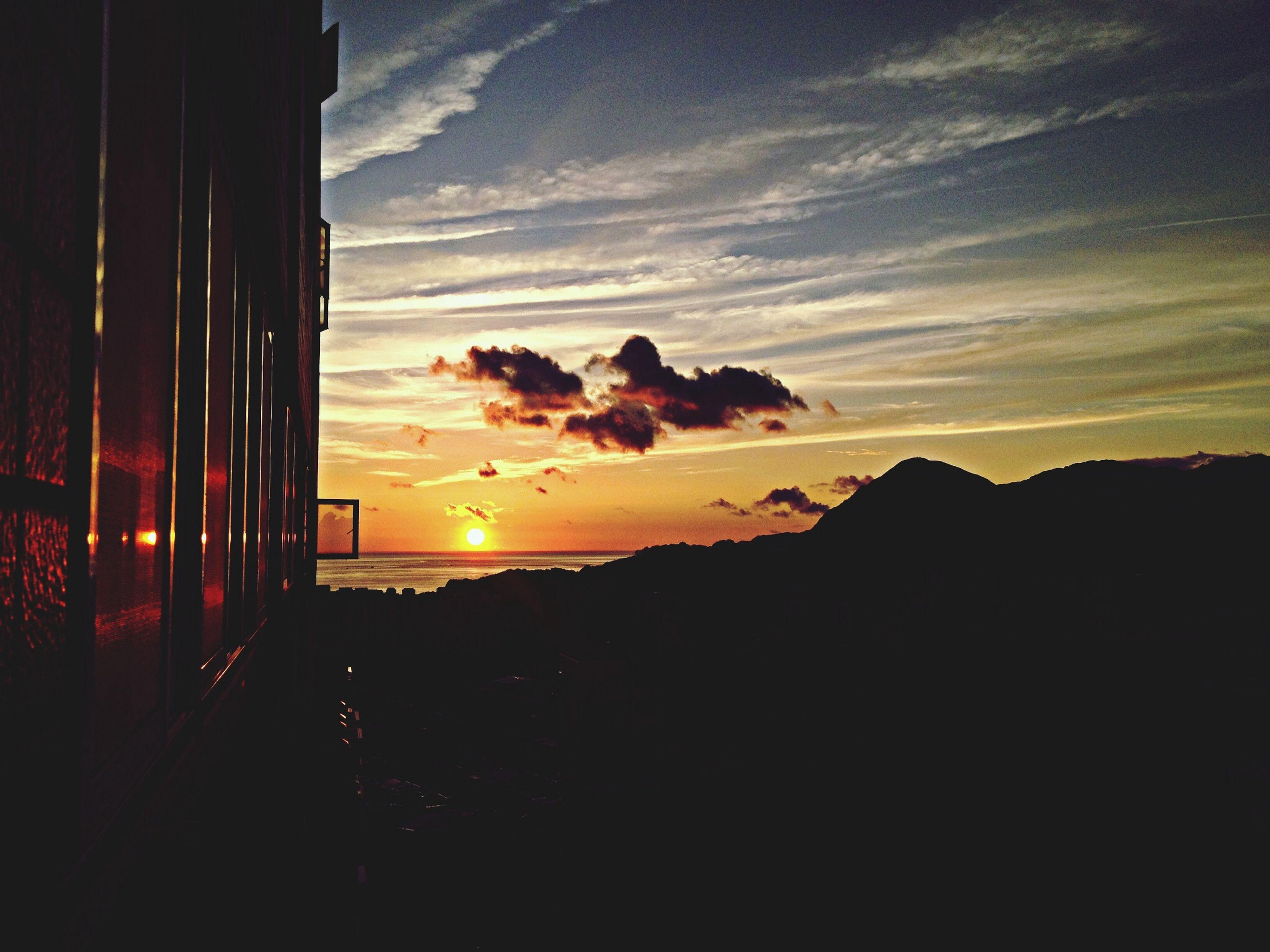 sunset, sky, silhouette, scenics, sun, tranquil scene, orange color, beauty in nature, sea, tranquility, idyllic, nature, cloud - sky, beach, horizon over water, mountain, sunlight, cloud, dark, water