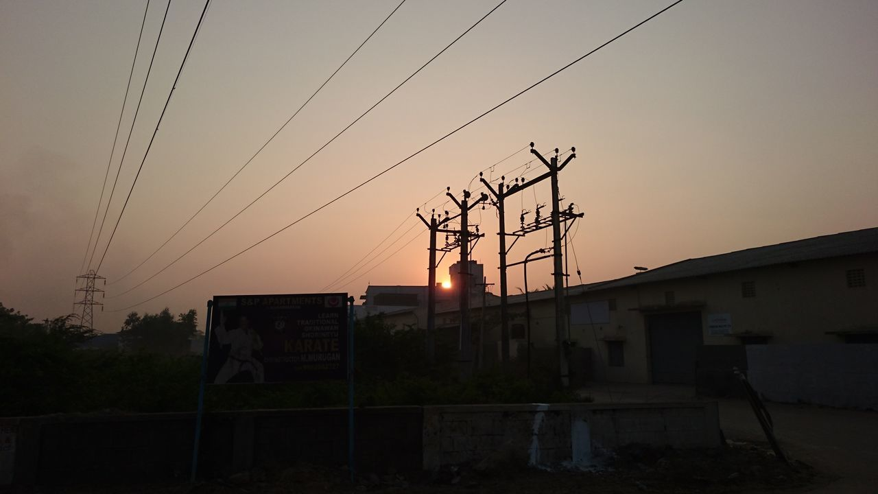 Architecture Building Exterior Built Structure Cable Connection Day Electricity  Electricity Pylon Fuel And Power Generation House No People Outdoors Power Line  Power Supply Residential Building Sky Sunset Technology Telephone Line Telephone Pole The City Light Tree
