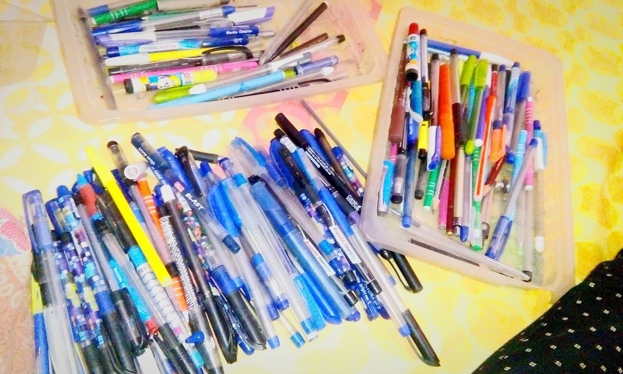 large group of objects, paintbrush, indoors, multi colored, choice, palette, variation, no people, desk organizer, close-up, day