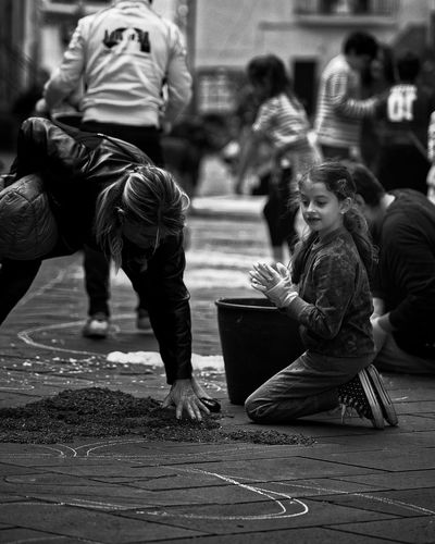 The Street Photographer - 2017 EyeEm Awards Real People Arts Culture And Entertainment Two People Lifestyles Togetherness Outdoors City Streetphotography Street Life City Women Young Adult Life Young Children Playing