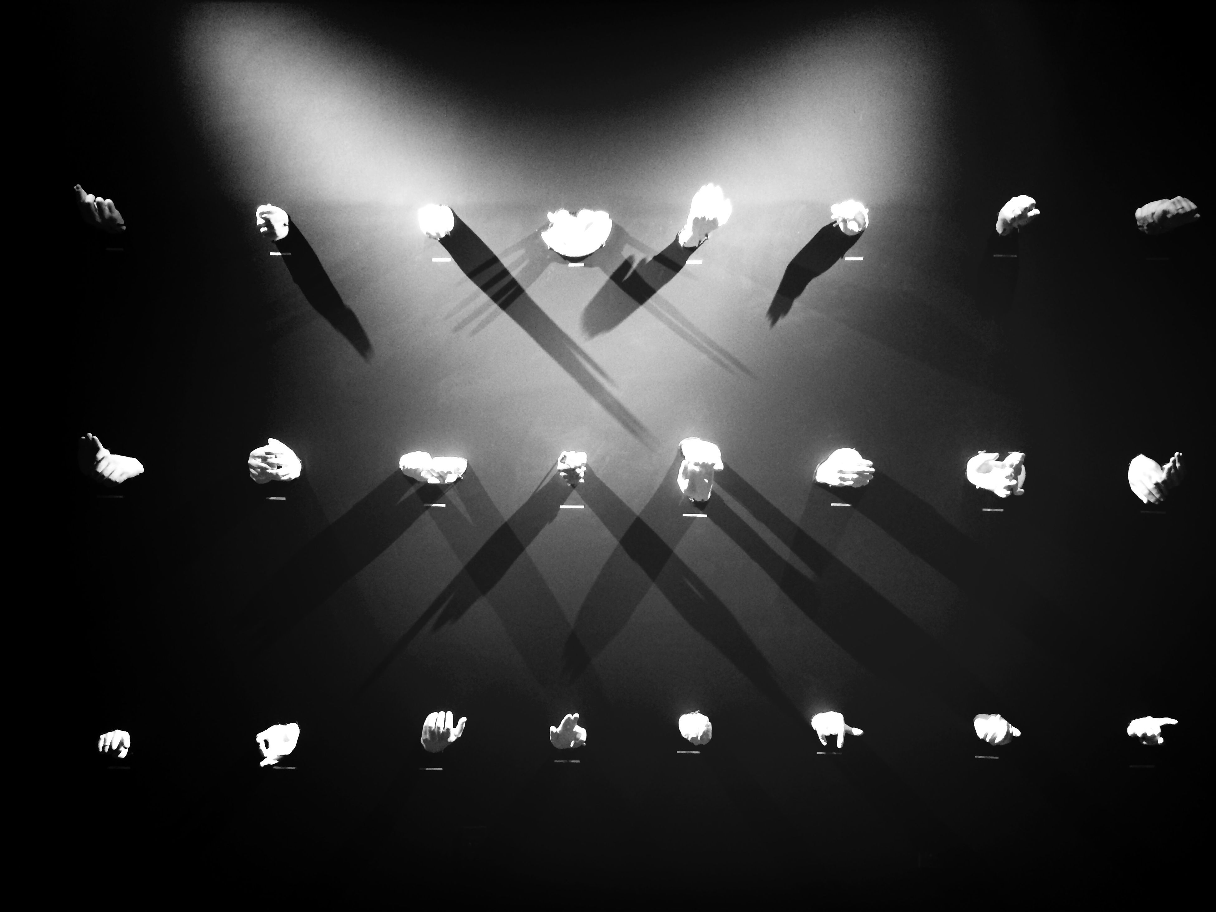 indoors, illuminated, lighting equipment, in a row, ceiling, night, light - natural phenomenon, electricity, electric light, no people, repetition, hanging, airport, order, large group of objects, side by side, technology, glowing, light bulb, arrangement