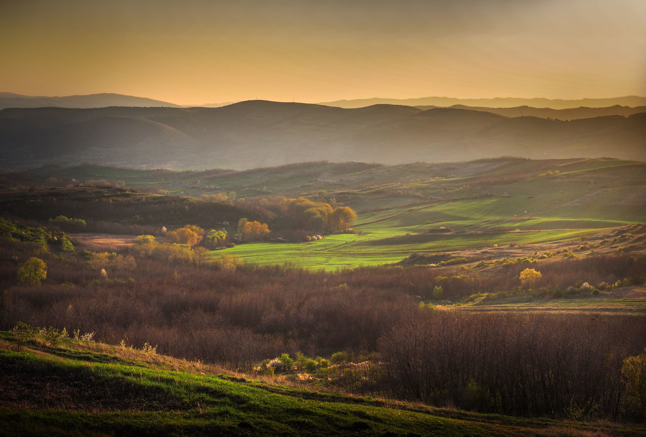 Beauty In Nature Grass Hills Hills And Valleys Landscape Mountain Nature No People Outdoors Silhouette Spring Spring Has Arrived Sunlight And Shadow Sunset Trees Warm Light