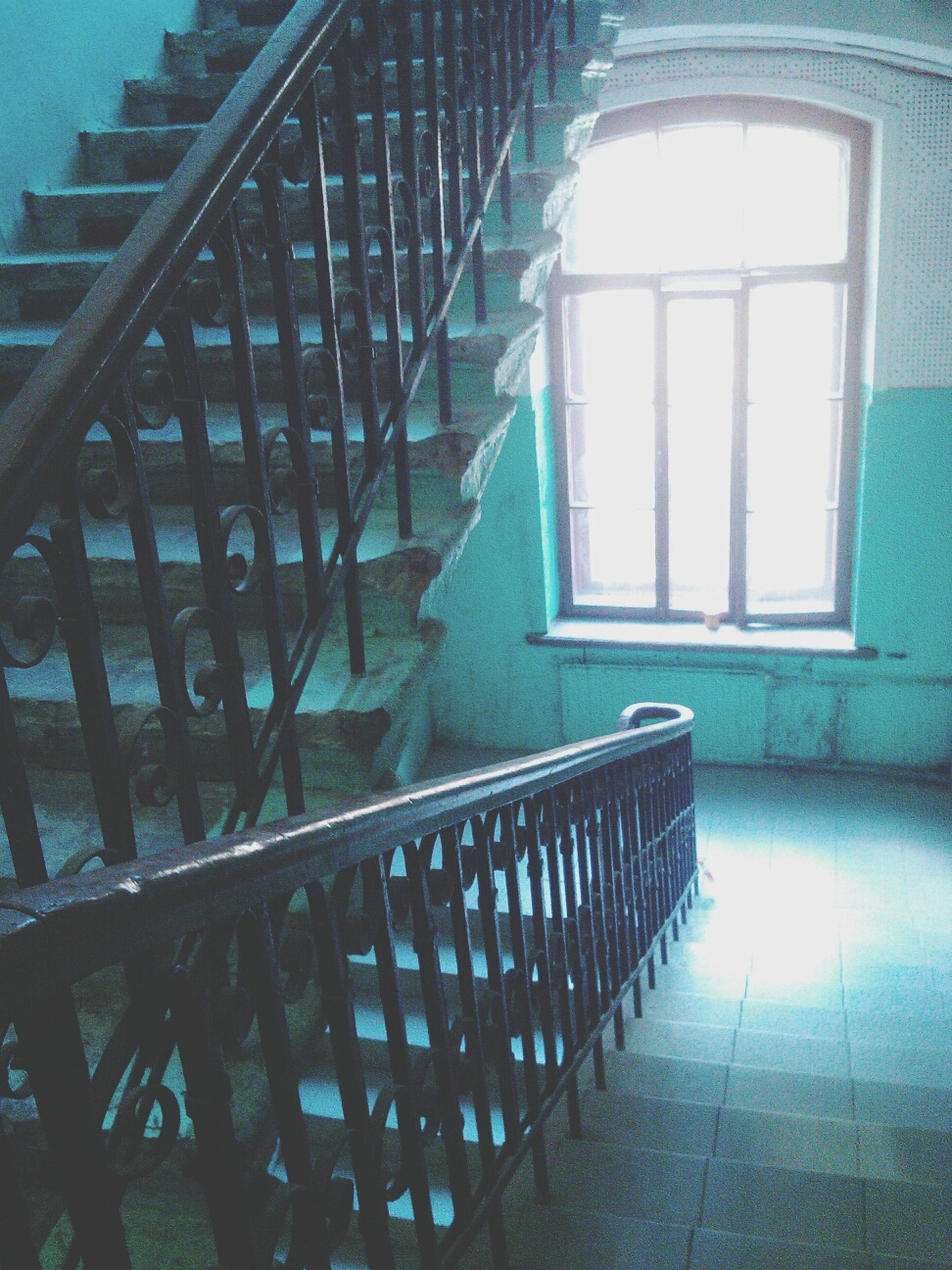 architecture, built structure, railing, indoors, window, steps, sunlight, staircase, steps and staircases, shadow, building exterior, empty, building, house, no people, absence, day, metal, wall - building feature, the way forward