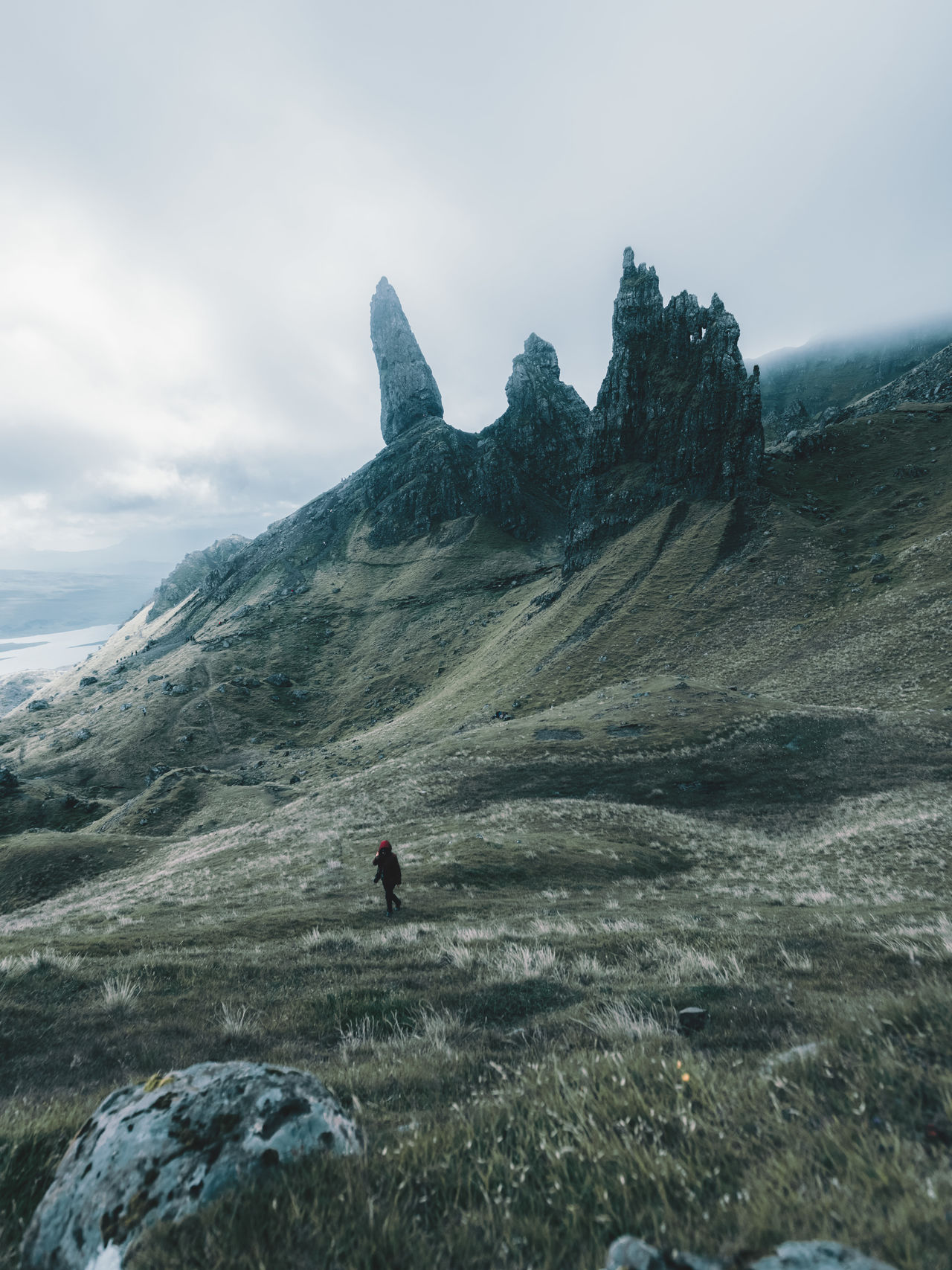 The old man of storr with a wanderer Adult Beauty In Nature Cold Temperature Day Isle Of Skye Landscape Mountain Nature Old Man Of Storr One Person Outdoors People Scenics Sky
