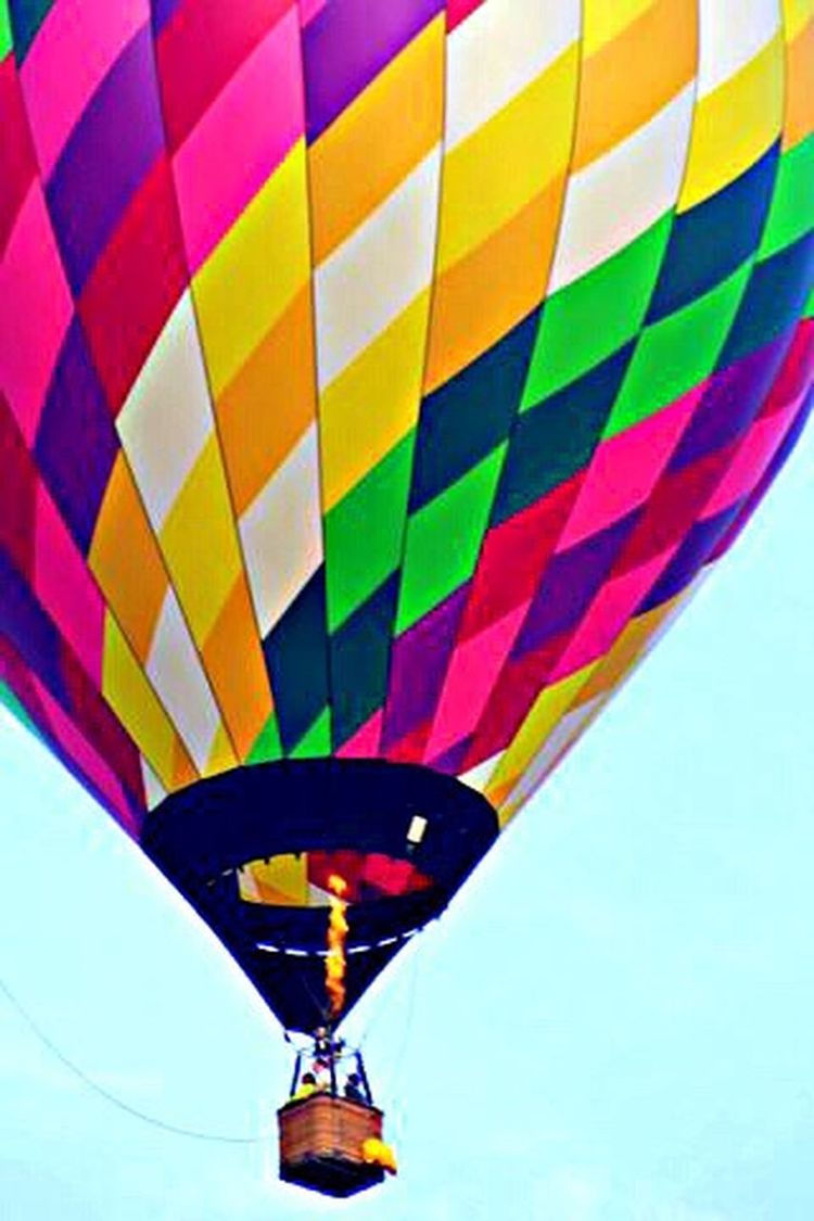 Hot Air Balloon Vibrant Colours Low Angle View Mid-air Sky Floating Heated Air Flame Basket People Flying Modeoftransportation
