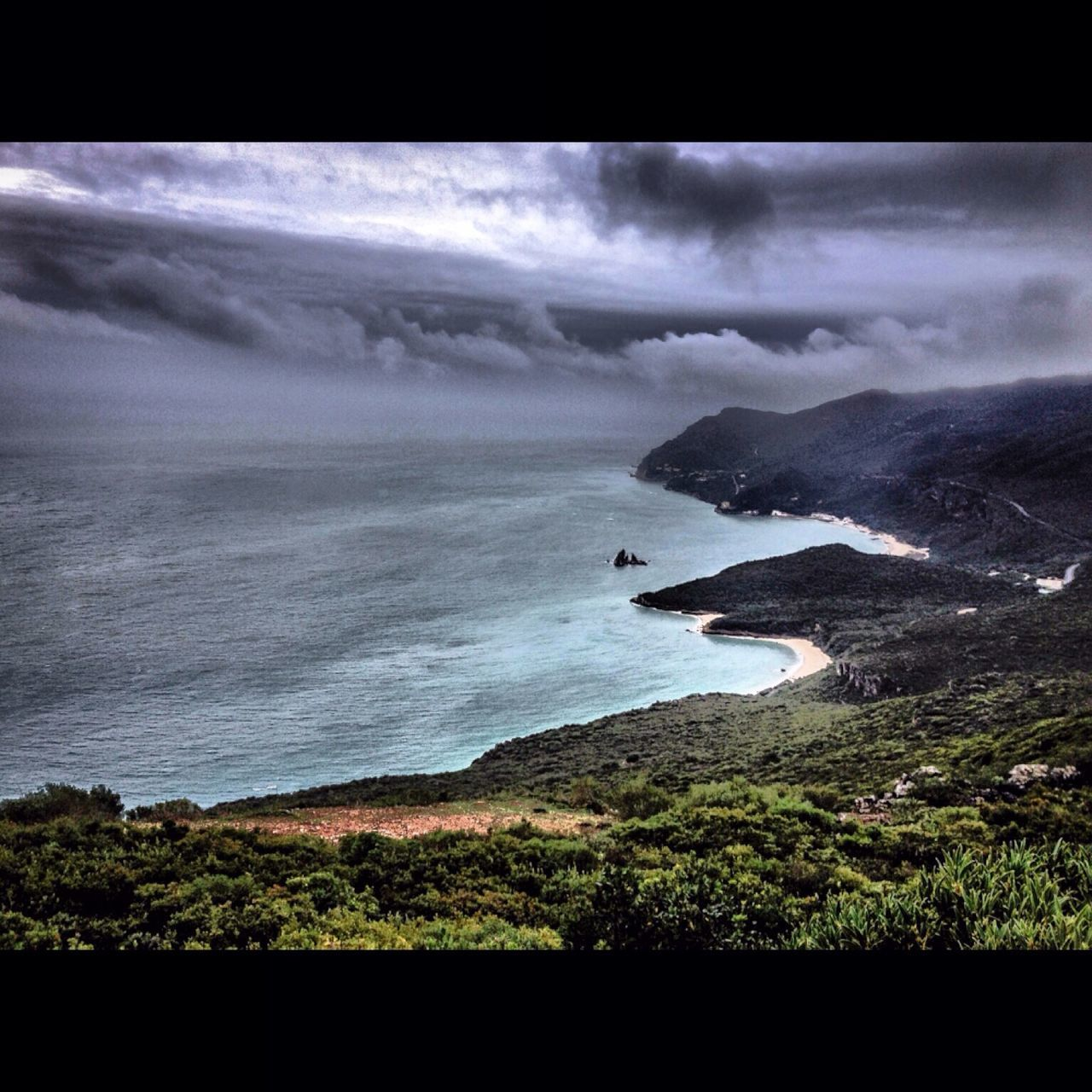 High Angle View Of Mountains And Sea Against Cloudy Sky