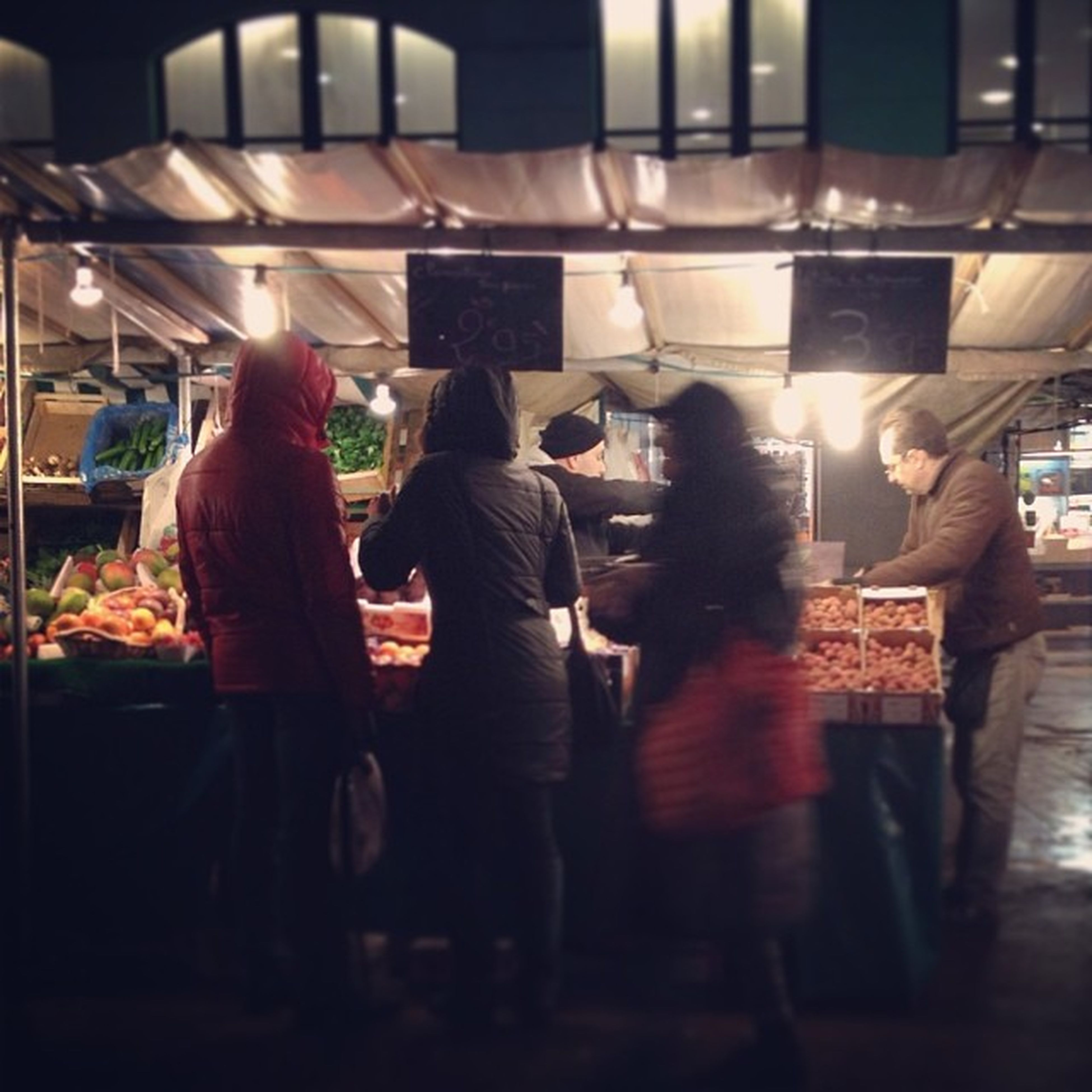 indoors, men, lifestyles, person, retail, standing, market, for sale, food and drink, market stall, choice, illuminated, leisure activity, large group of people, restaurant, medium group of people, business, rear view, store