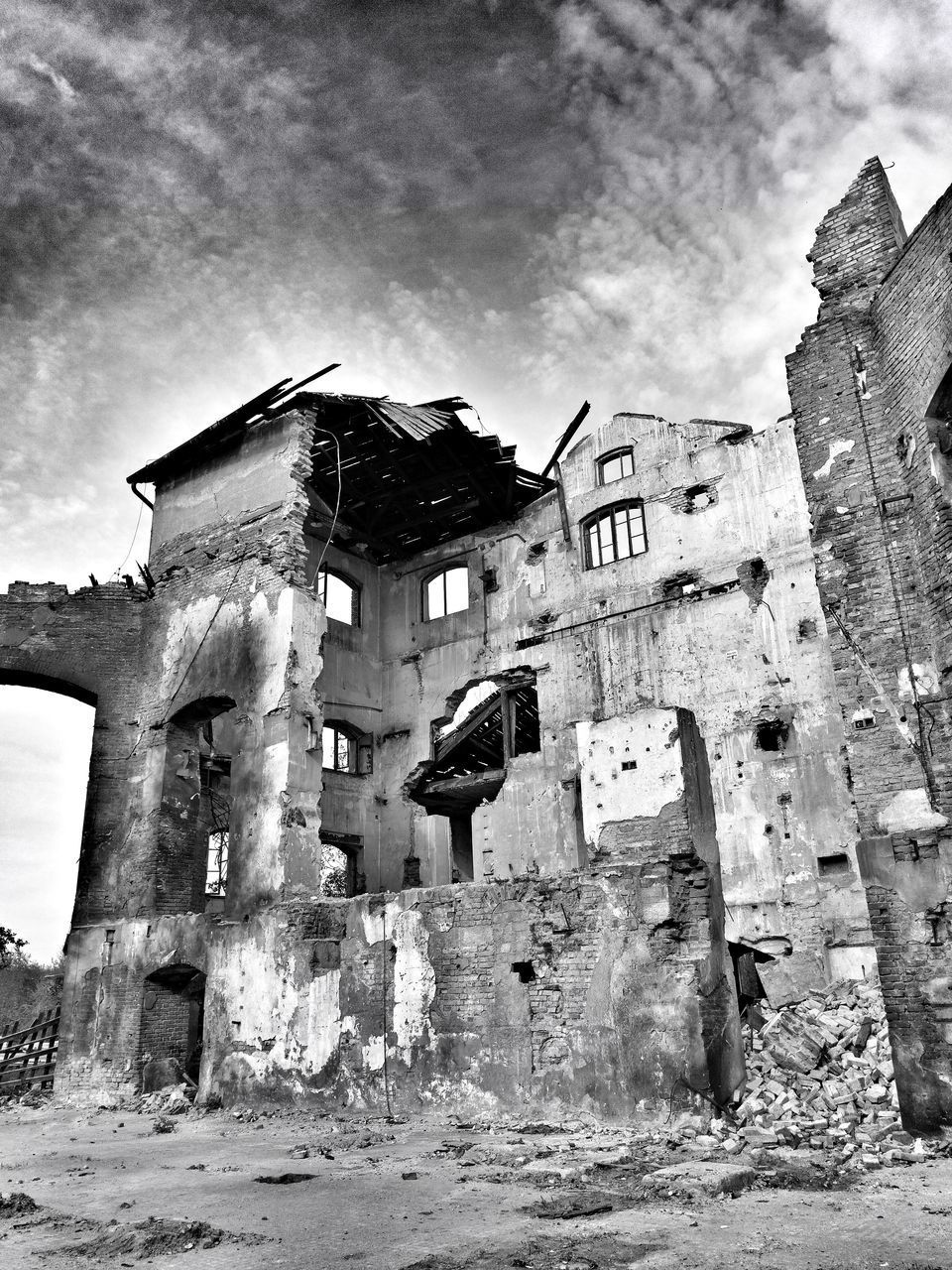 architecture, built structure, building exterior, damaged, abandoned, ruined, old, old ruin, run-down, obsolete, destruction, sky, bad condition, low angle view, day, no people, outdoors