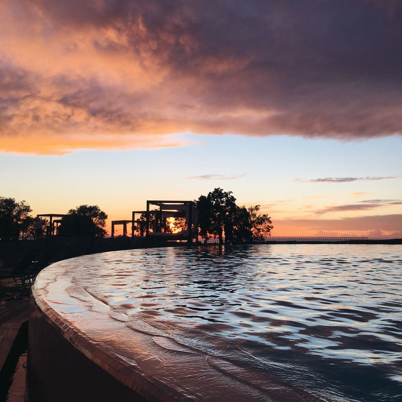 Sunset Water Sky Cloud - Sky Nature Tree Sunset Outdoors No People Beauty In Nature Built Structure Tranquility Sea Scenics Architecture Tranquil Scene Swimming Pool Day