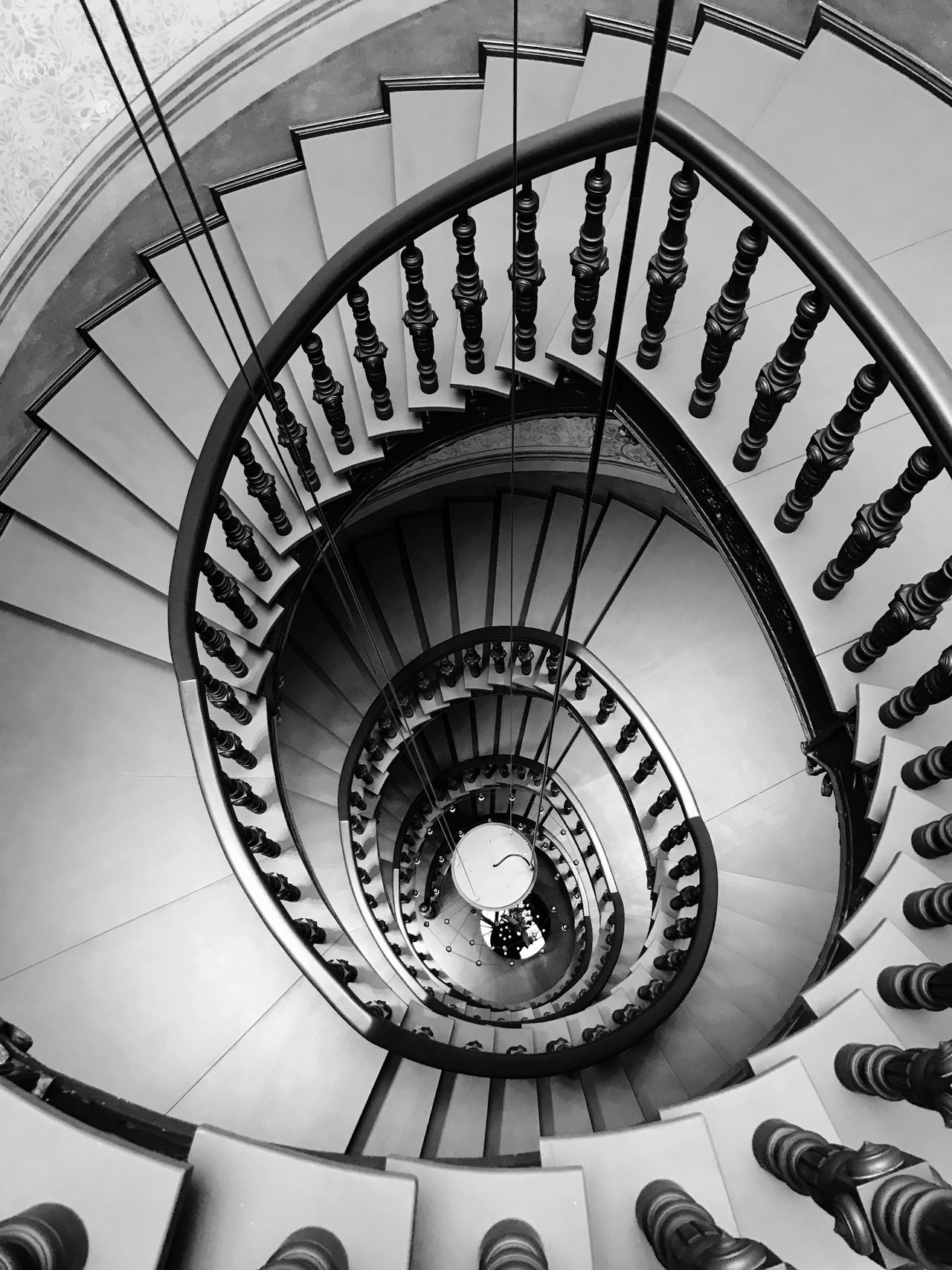 EyeEm Selects Staircase Steps And Staircases Spiral Steps Railing Spiral Stairs Stairs Architecture Built Structure High Angle View In A Row Hand Rail Indoors  Spiral Staircase Real People One Person Day People Shotoniphone7plus