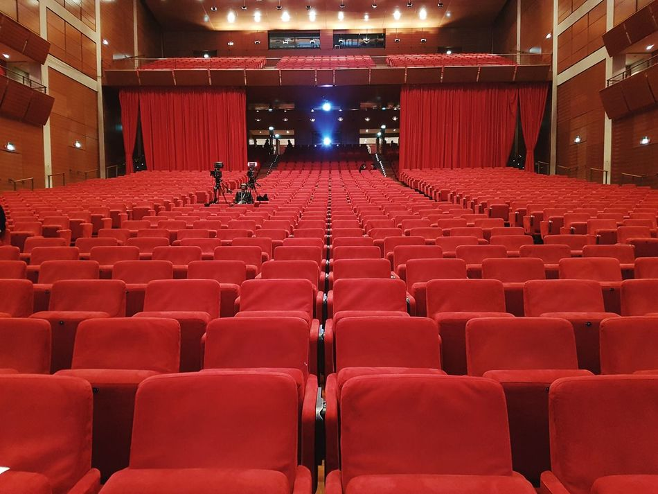 Red Auditorium Stage - Performance Space Indoors  Arts Culture And Entertainment Seat Lighting Equipment Stage Theater Performing Arts Event Chair Audience Illuminated Concert Hall  Minimalist Minimalism MOVIE Event Empty No People Monochrome