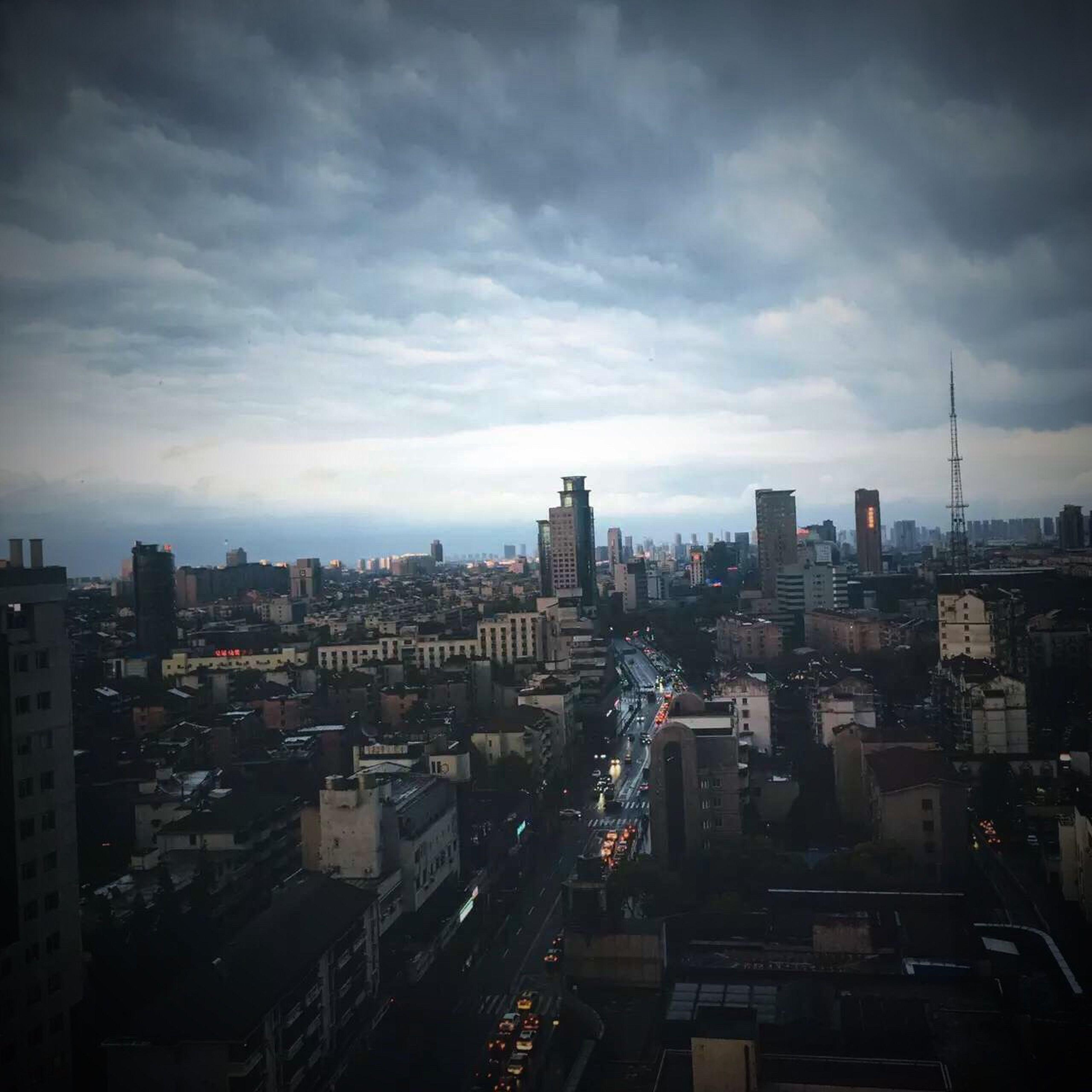 architecture, cityscape, building exterior, city, built structure, skyscraper, sky, no people, cloud - sky, travel destinations, outdoors, day