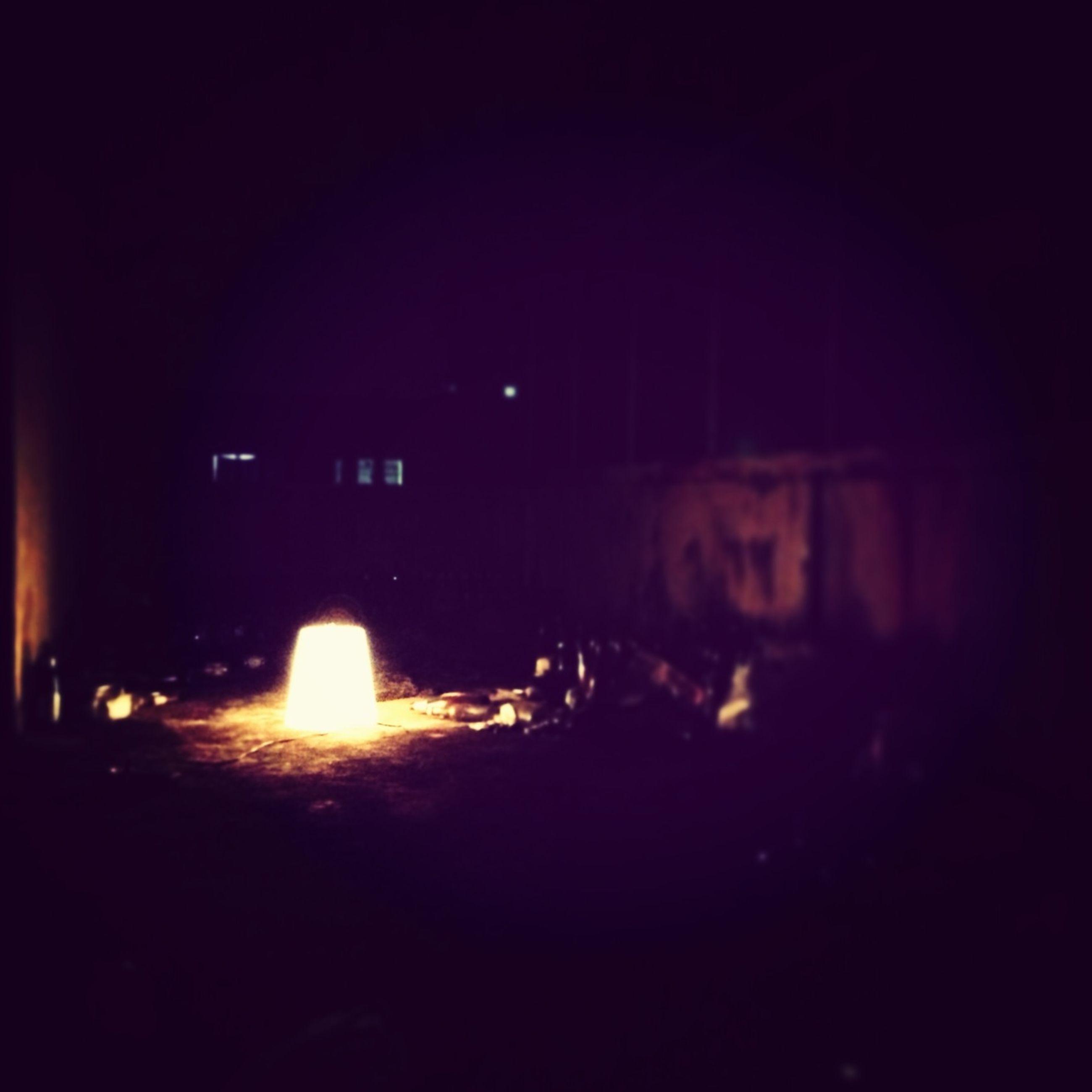 illuminated, night, dark, built structure, light - natural phenomenon, indoors, lighting equipment, architecture, glowing, copy space, building exterior, silhouette, men, darkroom, lit, flame, light, unrecognizable person