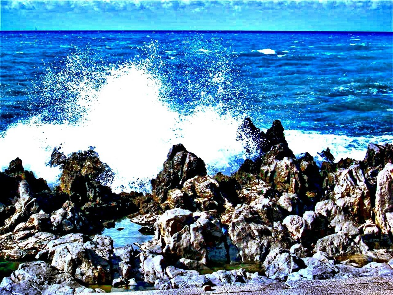 sea, water, rock - object, nature, beauty in nature, wave, horizon over water, scenics, day, no people, outdoors, beach, blue, power in nature