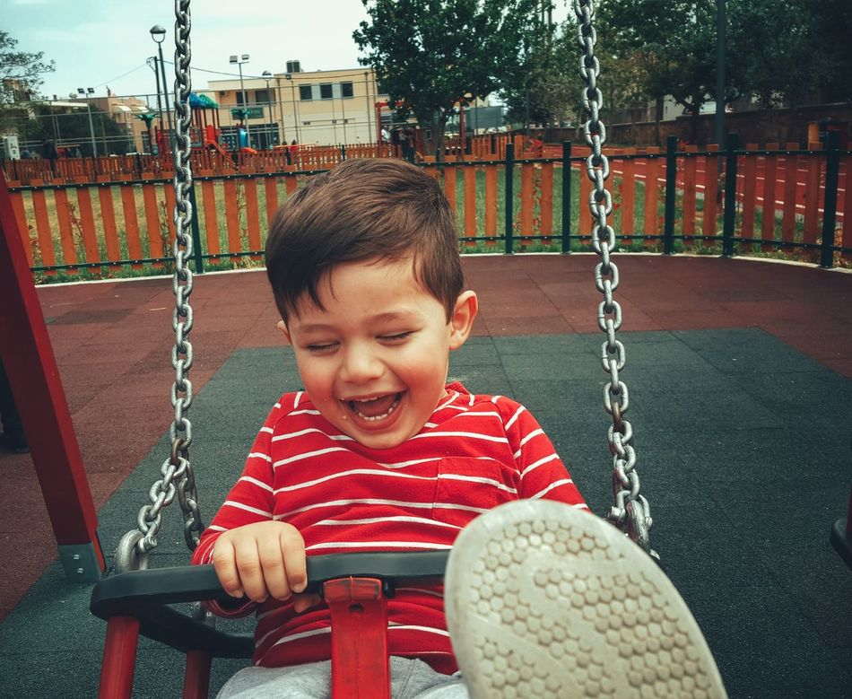 The Portraitist - 2016 EyeEm Awards Little Boy My Son Childsplay Close-up Children Photography Boy Child Childhood From My Point Of View Playground Swing Enjoying Life Loughing Playing Swinging Found On The Roll