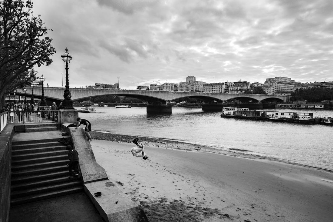 A jumping boy Architecture Blackandwhite Bresson Candid Photography City Decisive Moment Londonphotography Streetphotography Waterloobridge
