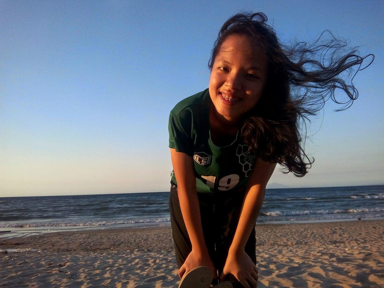 Beautiful stock photos of ostern, beach, sky, young adult, sea
