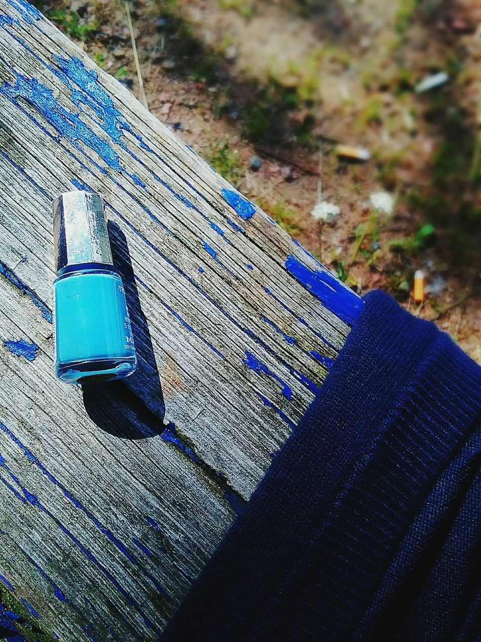 Nailpolish Everything Blue Colorsplash Theme Paint Worn Out Cardigan Outdoors Bench Wooden Little Bottle Detail Details Of My Life Pastel Blue Selective Focus No People Turquoise Makeup Light And Shadow Shades Of Blue Colour Of Life Color Palette Summertime Wooden Structure