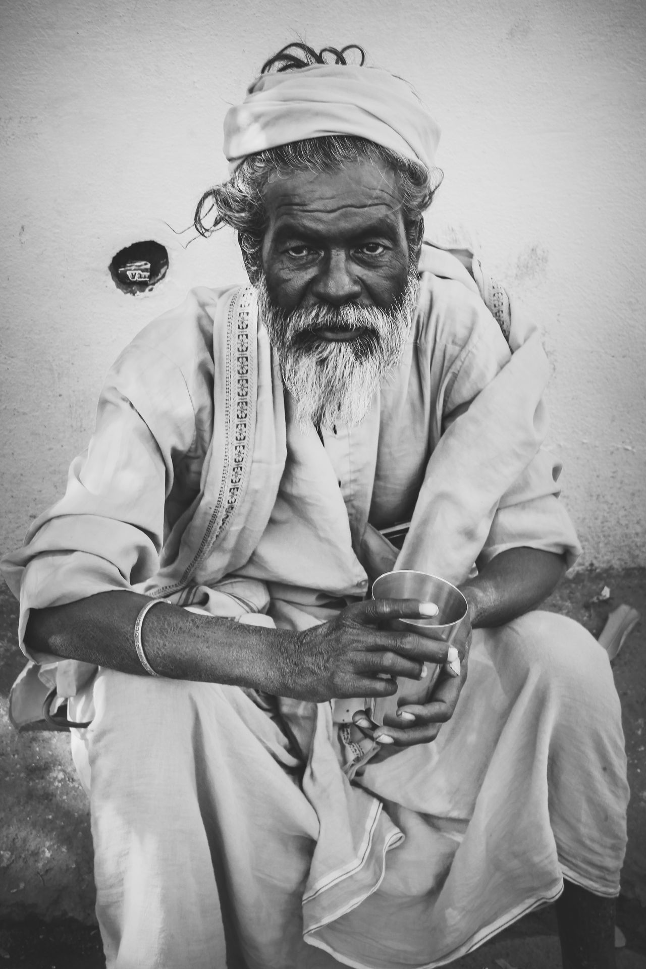 I AM GROUNDED. ARE YOU ? Beard Black And White Bw_collection Casual Clothing EyeEm Portraits Front View Human Indian Lookingup Monk  Old Age Portrait Resting Road Side The Portraitist - 2016 EyeEm Awards