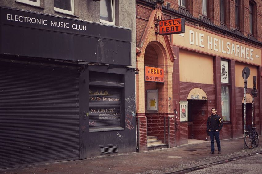 Jesus and the club Text Building Exterior Entrance Communication Outdoors Day One Person Real People City Adult Electronic Music Shots Jesus St. Pauli Club Electronic Music Nightlife Streetphotography Strassenfilm Liebe Love ♥ Religion Urban Street Hamburg