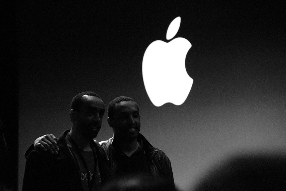 Two iOS developers posing for a photo at the 2010 Apple worldwide developer conference. Illuminated Headshot Night Casual Clothing Focus On Foreground Electric Light Creativity Apple 2010 WWDC Logo Black And White