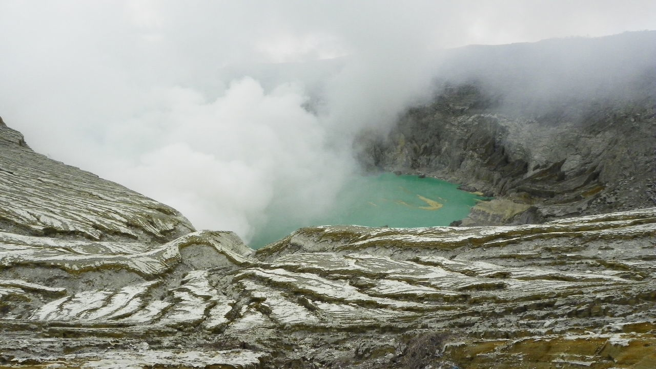 Kawah Ijen crater, Java, Indonesia Beauty In Nature Crater Crater Lake Day Erosion Gas Geology Kawah Ijen Natural Natural Phenomenon Nature No People Outdoors Physical Geography Scenics Sky Smoke Sulphur Toxic Volcanic Landscape Volcano Wasteland Water