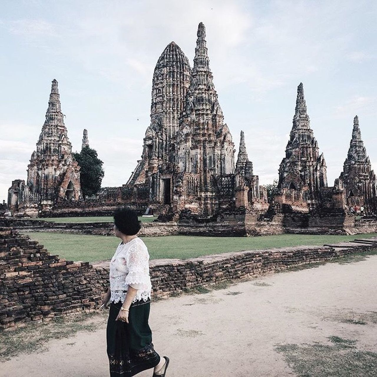 spirituality, religion, place of worship, architecture, real people, old ruin, built structure, building exterior, history, leisure activity, lifestyles, one person, travel destinations, sky, rear view, ancient, men, day, women, ancient civilization, outdoors, statue, standing, young adult, adult, people