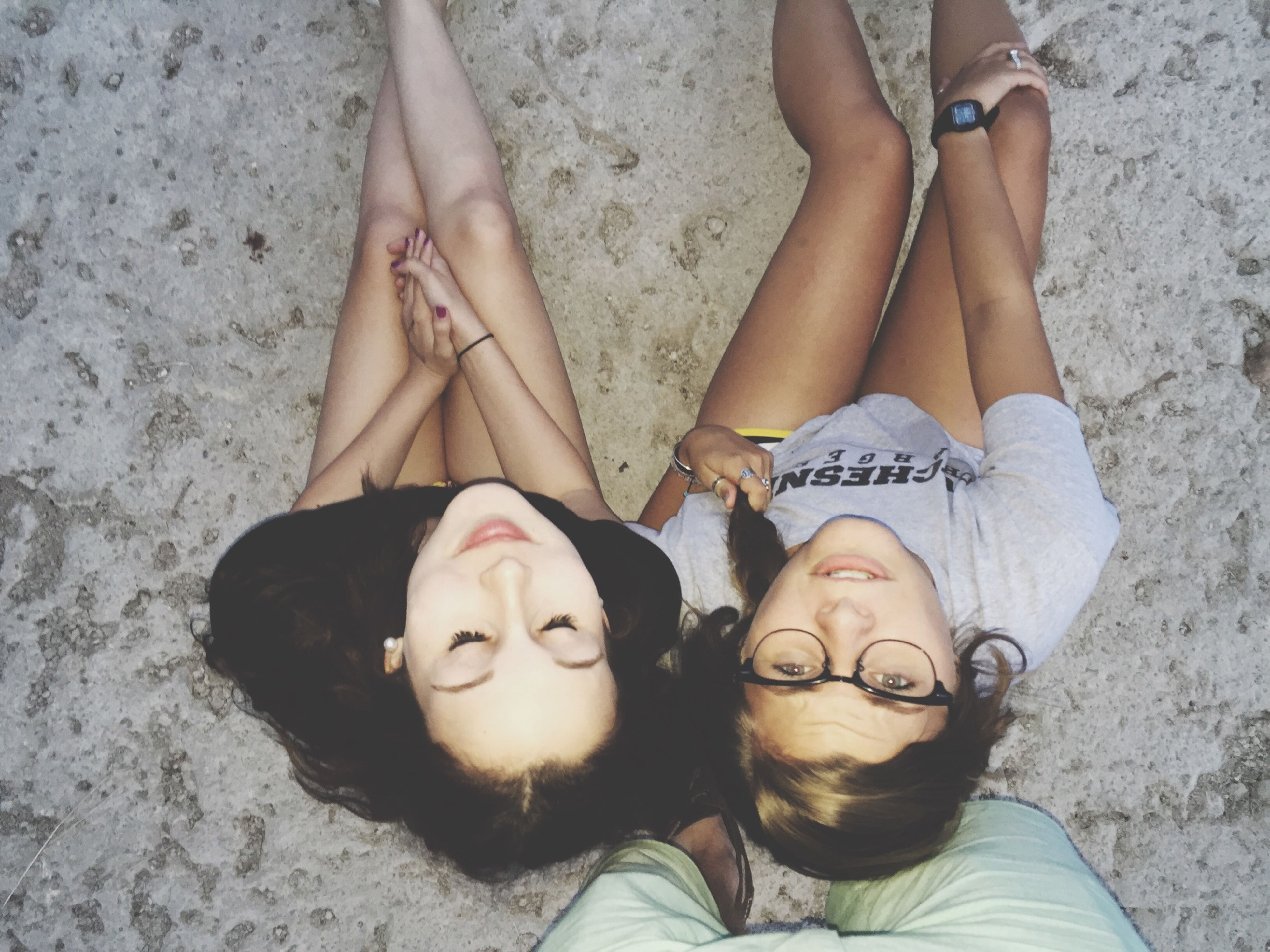 lifestyles, leisure activity, young adult, young women, togetherness, person, bonding, casual clothing, sitting, beach, portrait, relaxation, love, looking at camera, standing, friendship