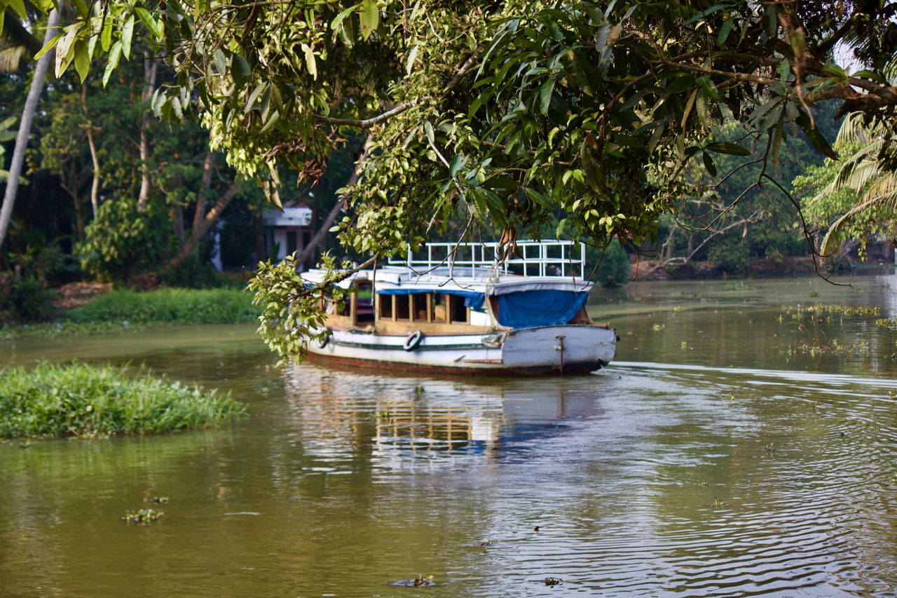 Beauty In Nature Boat Boat Ride Green Lake Lifestyles Mode Of Transport Natural Beauty Nature Nautical Vessel Old Boat River Scenery Scenics Tee Tranquil Scene Tranquility Transportation Travel Travel Destinations Traveling Tree Water Water Reflections Waterfront