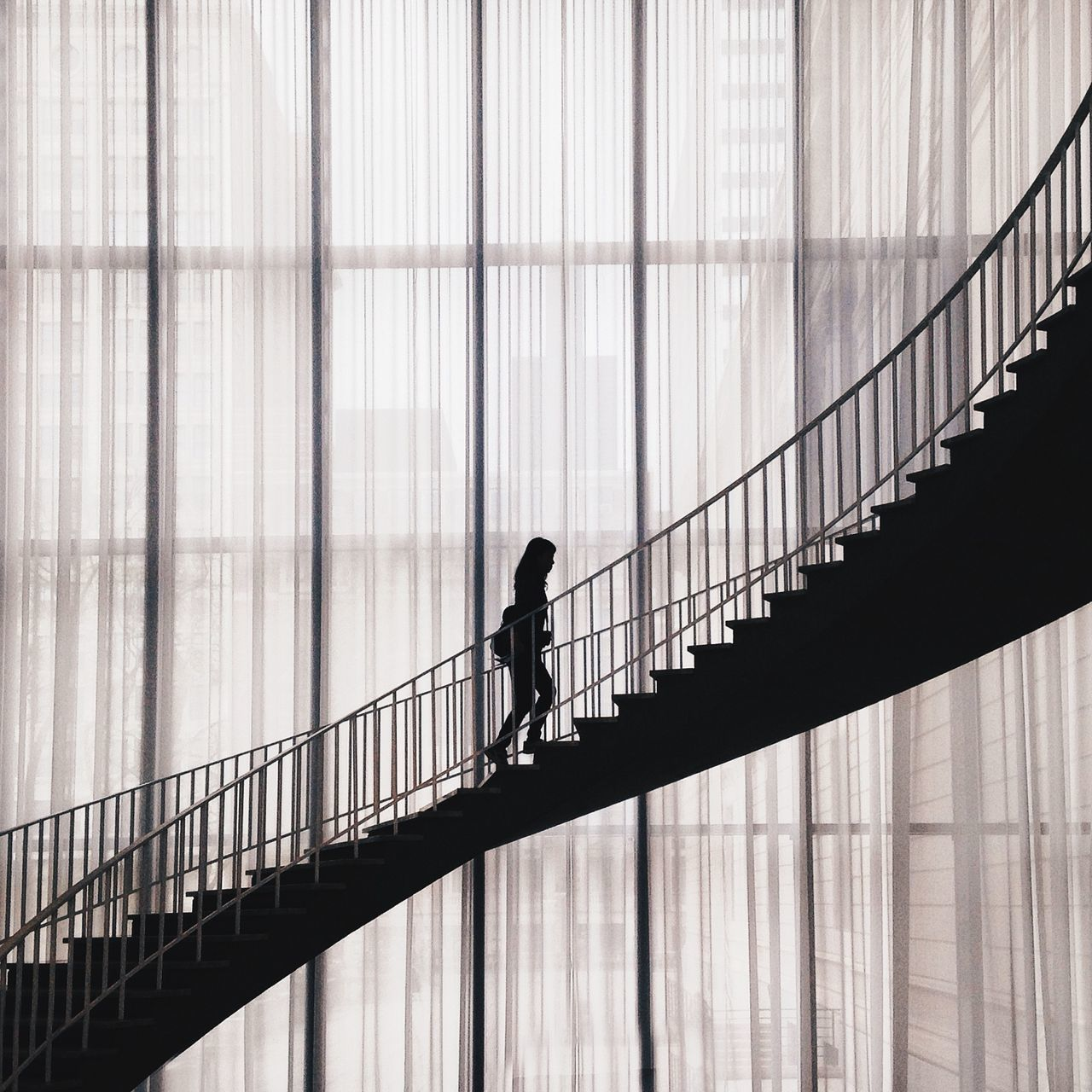 Silhouette Woman Walking On Staircase In Building