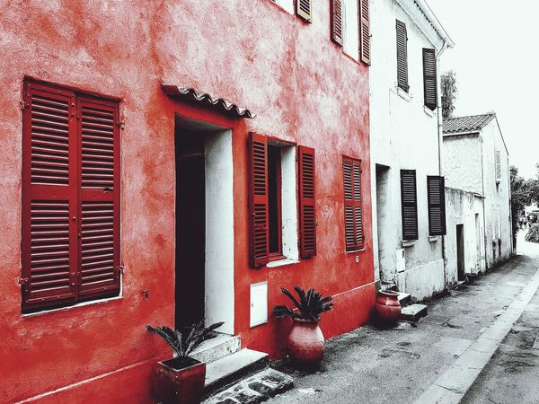 Hanging around Taking Photos Hanging Out ColorPalette Colorsofsummer Streetphotography Blackandred Doorstep Window View