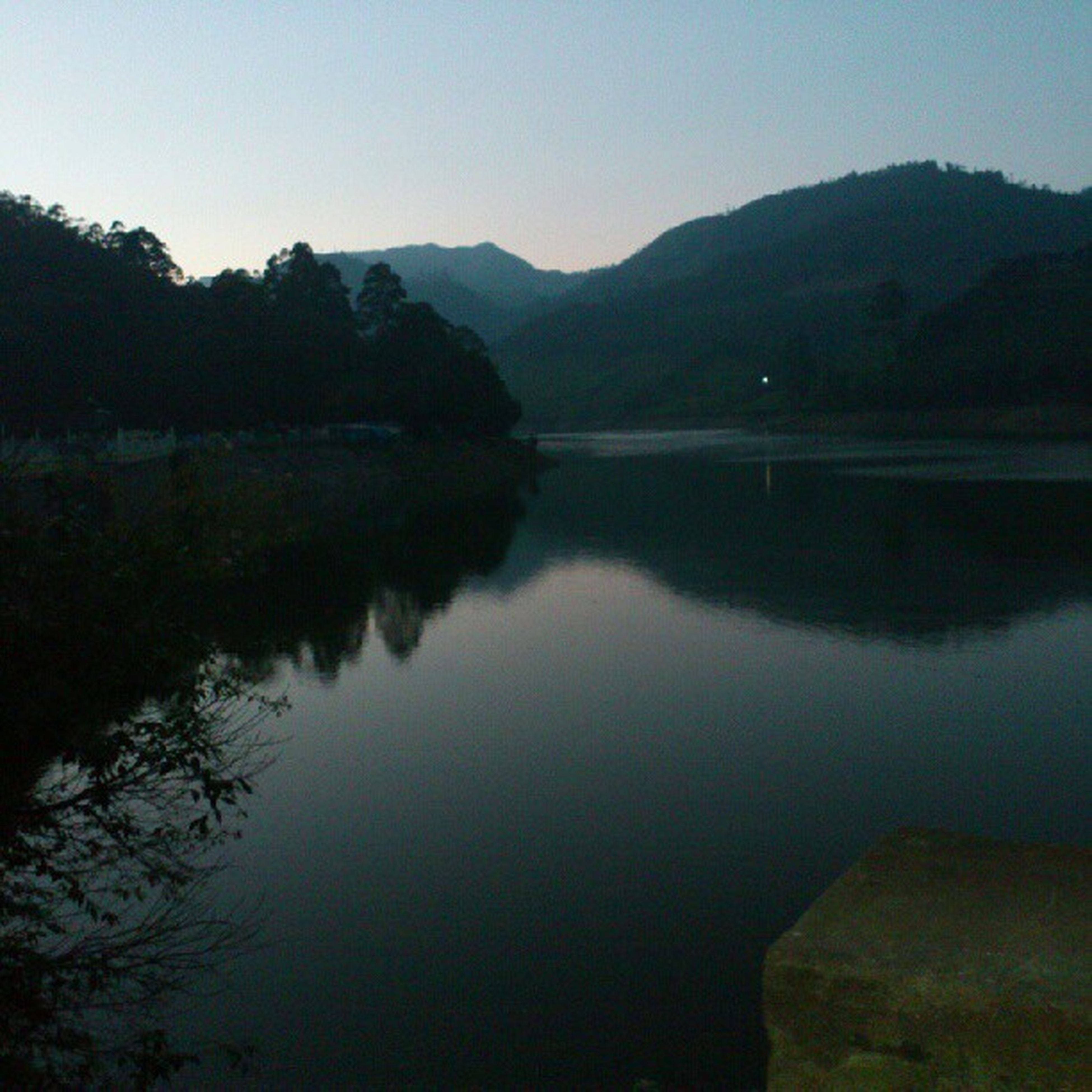 water, lake, reflection, mountain, tranquility, tranquil scene, scenics, beauty in nature, mountain range, clear sky, nature, tree, standing water, calm, idyllic, river, sky, countryside, lakeshore, non-urban scene