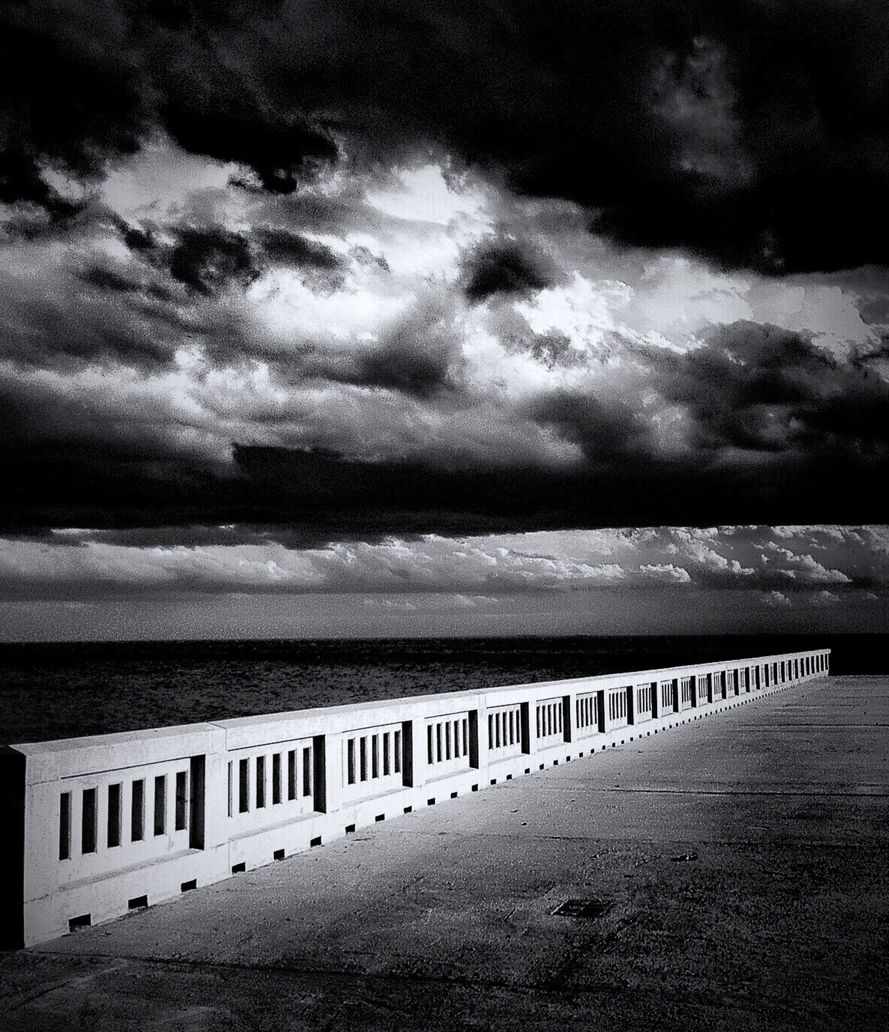 sea, sky, water, cloud - sky, horizon over water, tranquil scene, tranquility, scenics, cloudy, beach, beauty in nature, nature, railing, pier, cloud, weather, shore, idyllic, overcast, dusk
