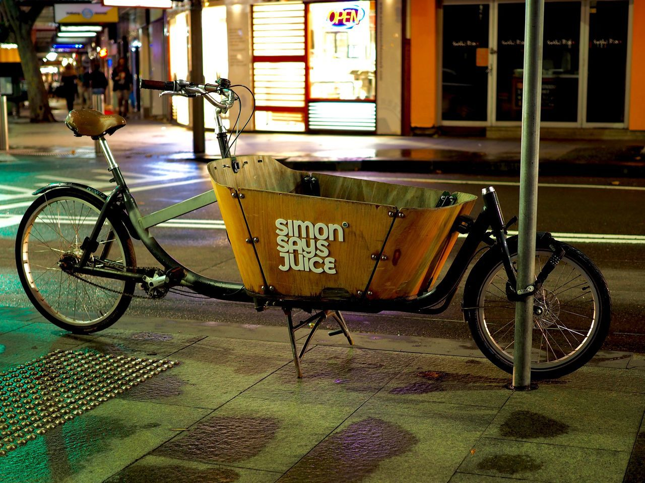bicycle, mode of transport, text, transportation, land vehicle, stationary, city, no people, outdoors, day