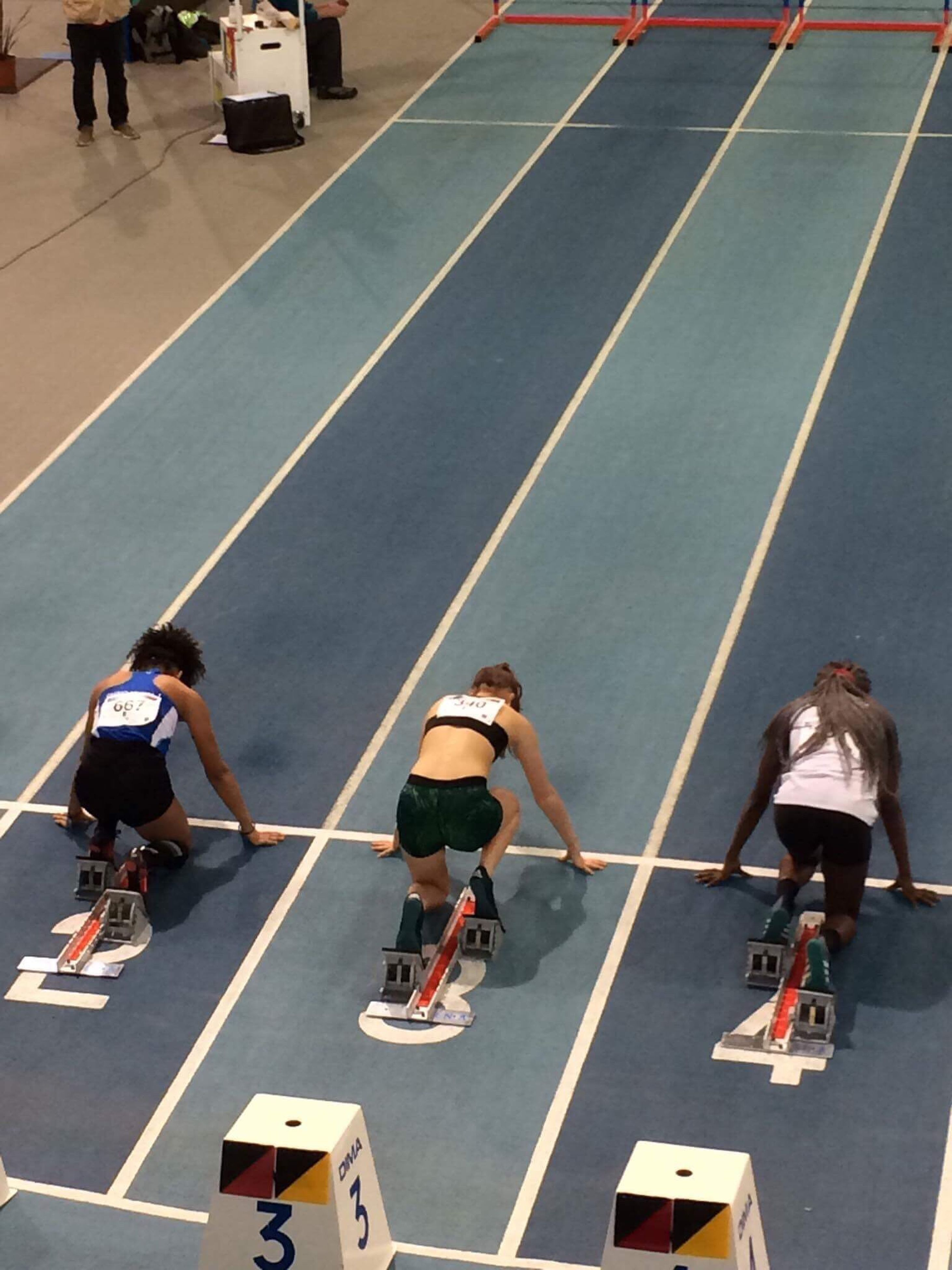 high angle view, adults only, men, adult, real people, competitive sport, women, people, sportsman, competition, only men, outdoors, physical impairment, young adult, sports race, sports track, day, athlete, track and field, sports uniform, track and field athlete